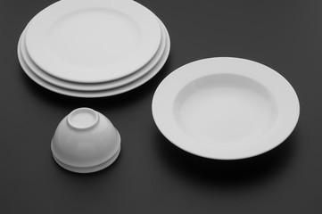 kitchen and restaurant utensils, plates, on a dark background