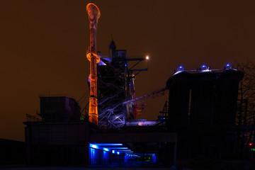 Night shot of Landschaftspark Nord, old illuminated industrial ruins in Duisburg, Germany