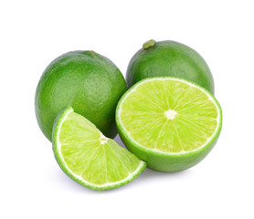 Limes with slices isolated on white