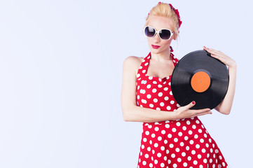 Girl pin-up retro holding a vinyl record