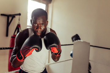 Focused intense African boxer staring at camera