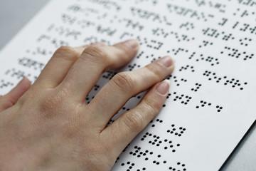 blind reading, fingers and symbols closeup
