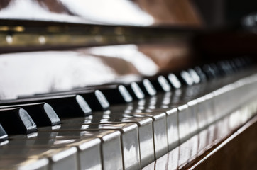 Piano keyboard background with selective focus and blurred background.