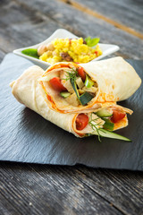 Delicious homemade tapas tortilla with couscous and nuts on a wooden background