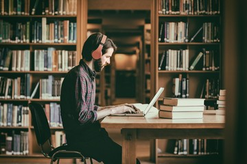 Hipster student studying in library