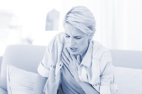 Pretty blonde woman having breath difficulties