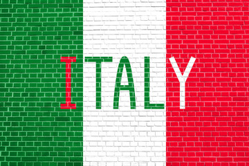 Italian flag and word Italy on brick wall
