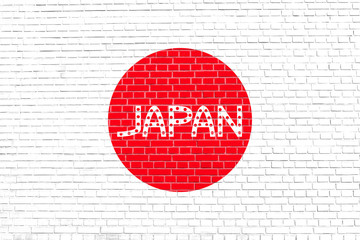 Japanese flag and word Japan on brick wall