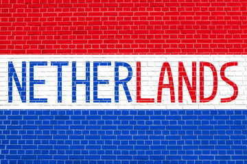 Netherlands flag and word Netherlands on brick wall