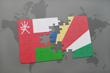 puzzle with the national flag of oman and seychelles on a world map background.