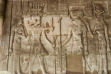 Hieroglyphic carvings on the exterior walls of  egyptian temple