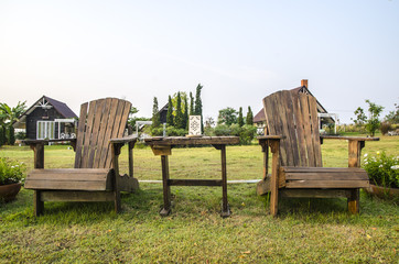 Two wooden empty lawn chairs