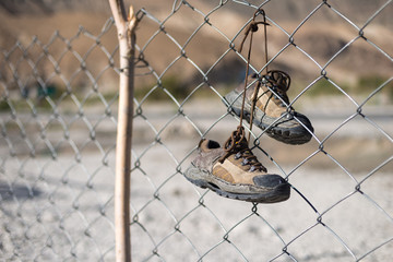 Adventure shoes on fence, wash and dry shoes