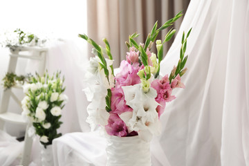 Beautiful decorated interior with bouquet of flowers in vase