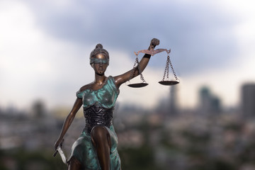 Lady Justice and city view