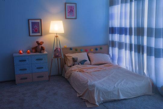 Bed in children room interior