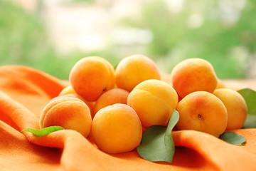 Fresh apricots on orange napkin