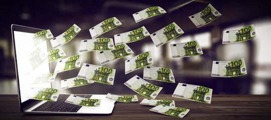 Notebook spuckt Geldscheine aus.