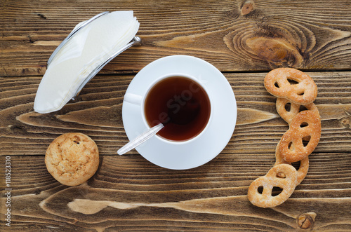 Cup of tea on a wooden table sugar spoon biscuits for Table 52 goat cheese biscuits
