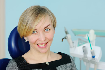 beautiful young blonde woman in the office of the dentist