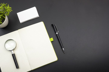 Business card blank, notepad, flower and pen at office desk table top view. Corporate stationery branding mock-up