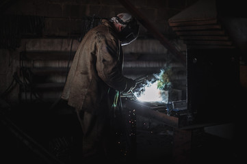 job of a welder. A large concrete products plant and welding on it.