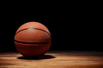 Basketball on a hardwood court floor