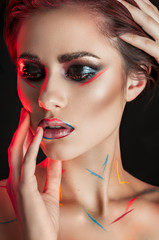 Fantasy woman portrait. Beautiful fashionable model with red hair and brown eyes closeup. Creative make up.