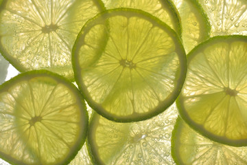 Lime slices in water with bubbles