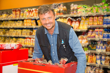 Sales assistant doing a stocktake at supermarket