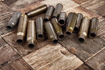 Bullets shells on wooden background. Stock image macro.
