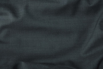 A full page close up of charcoal grey suit fabric texture