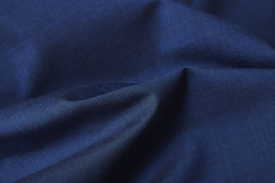 A full page close up of royal blue suit fabric texture