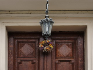 Church wooden door entrance with lamp above