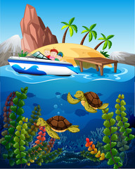 People in boat and turtles under the sea