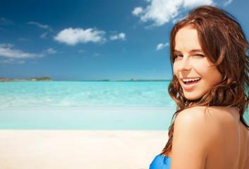 happy beautiful woman on tropical beach