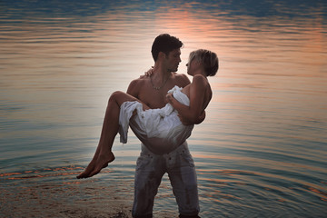 Romantic couple in lake waters