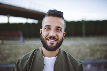 Portait of smiling man with beard and shaved head