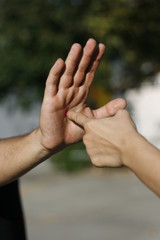 female finger to man's palm into the center