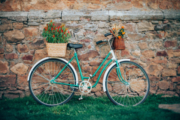 Beautiful vintage bicycle with flowers in baskets