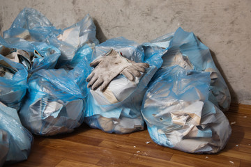 Working gloves. Collect garbage in the garbage bag, put things in order. Do makeovers.