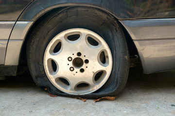 Flat tires / View of flat tires of car was abandoned.