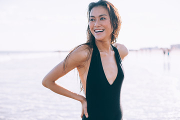 A beautiful tan girl on her sexy black swimsuit