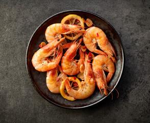 fried prawns on black plate