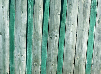 Grungy green and gray wooden fence texture.