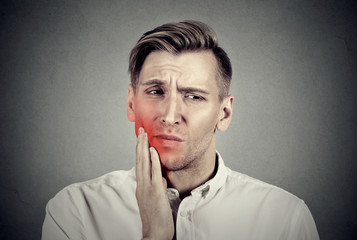 Man with sensitive toothache problem about to cry from pain