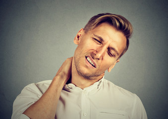 man with neck pain, after long hours of work