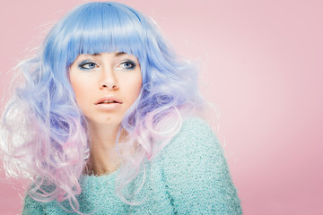 Gorgeous young woman with pastel blue and pink hair. Fashion model with colorful hair