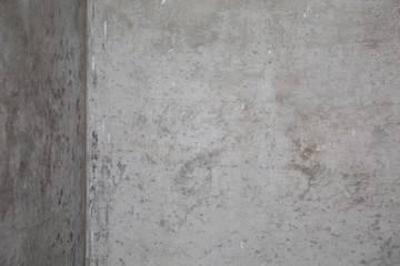Old grungy texture, grey concrete wall . Abstract gray interior with concrete wall . Vintage style, angle at room.