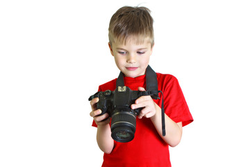 Boy looks at the photo on the camera